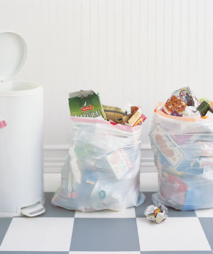 Two bags of garbage in kitchen