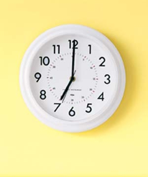 White clock on yellow wall