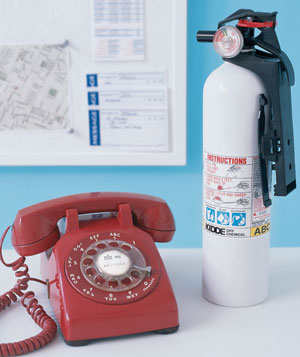 Phone and fire extinguisher on a table