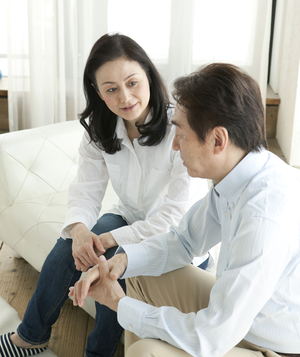 Couple in discussion on sofa