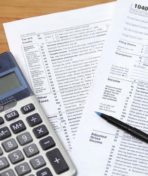 Tax forms, calculator, and pen