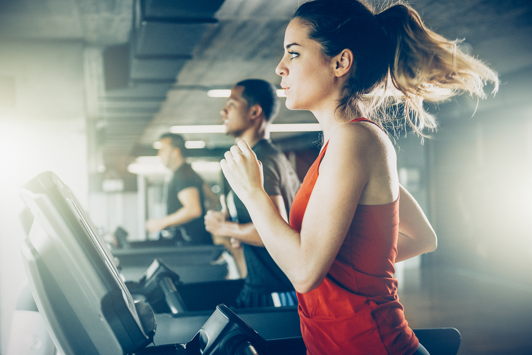 Woman with ponytail running on treadmill