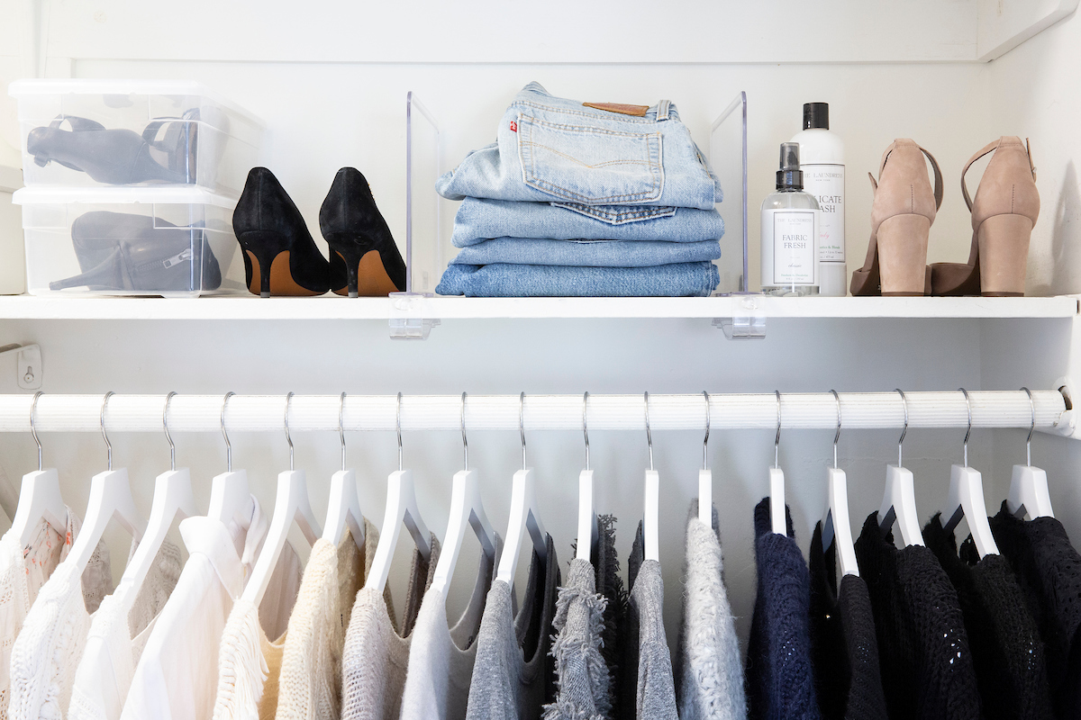 Organized closet with shoes and sweaters
