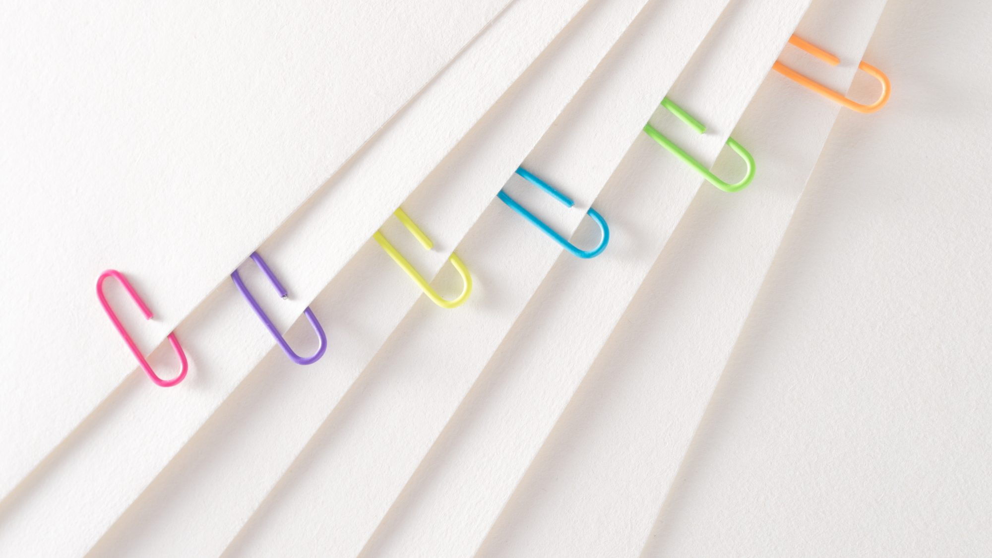 image of file folders with paper clips: How to Organize Paper Clutter