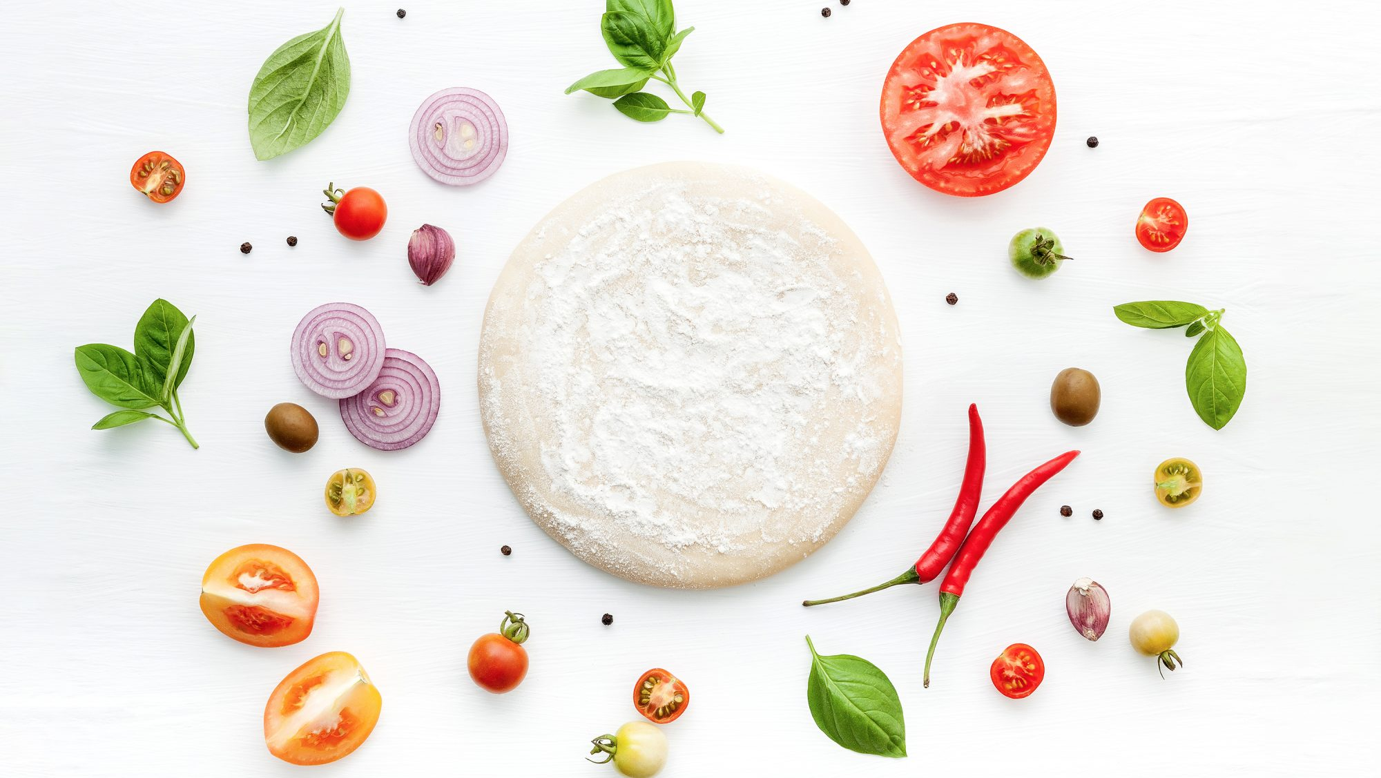 instant pot pizza dough, surrounded by vegetables