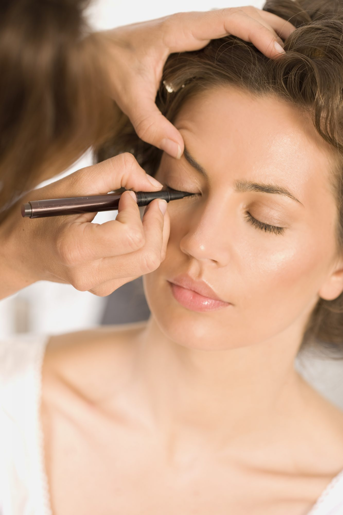 Woman getting her makeup done.