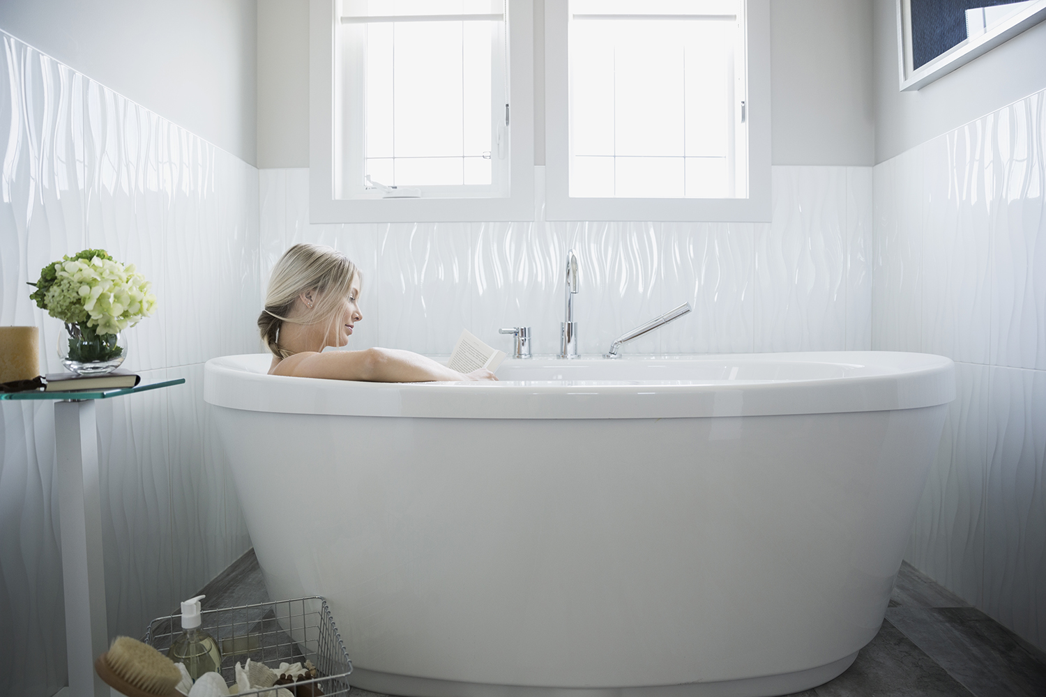 Woman Reading a Book in the Bath