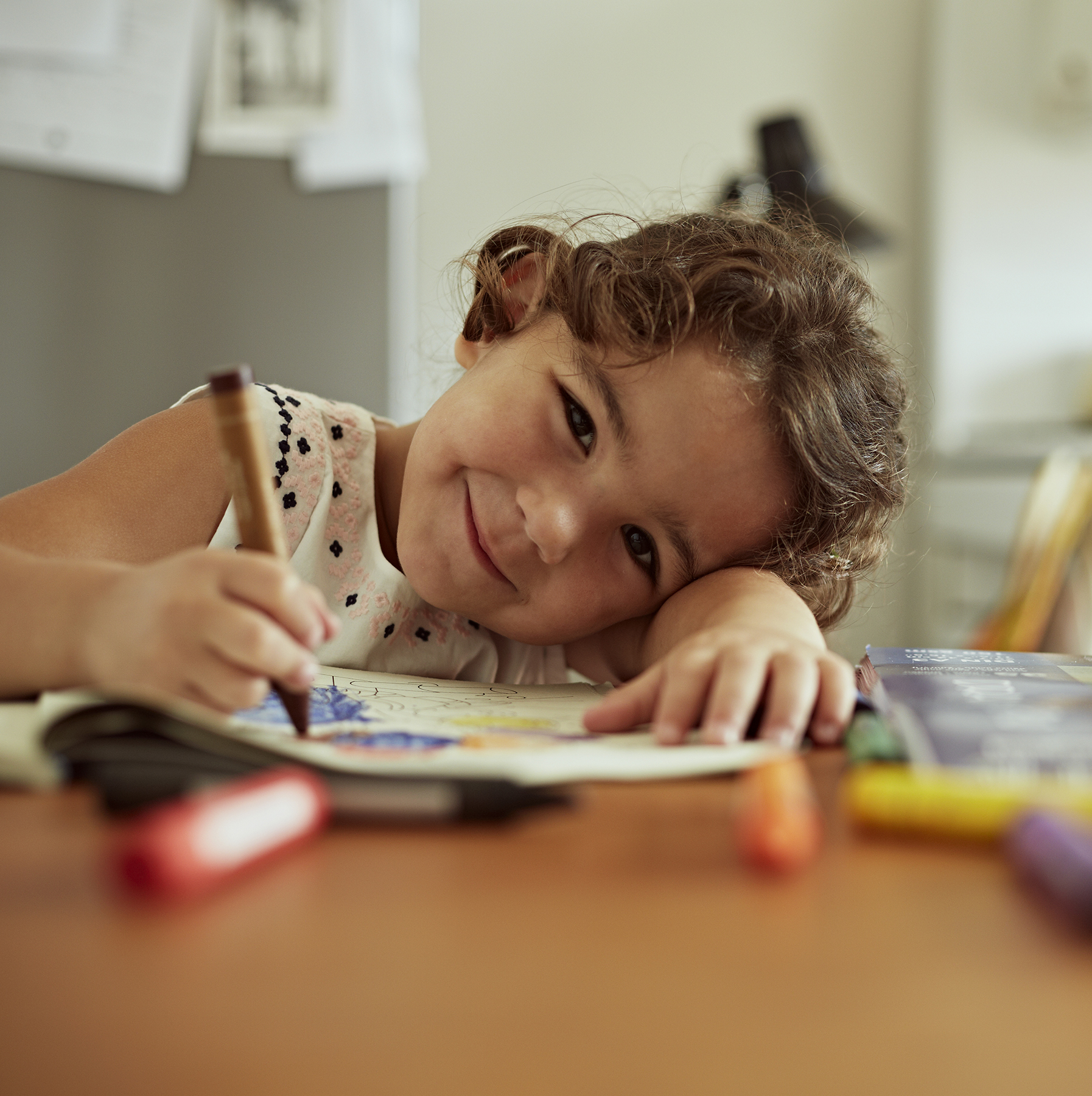 Child drawing in kitchen