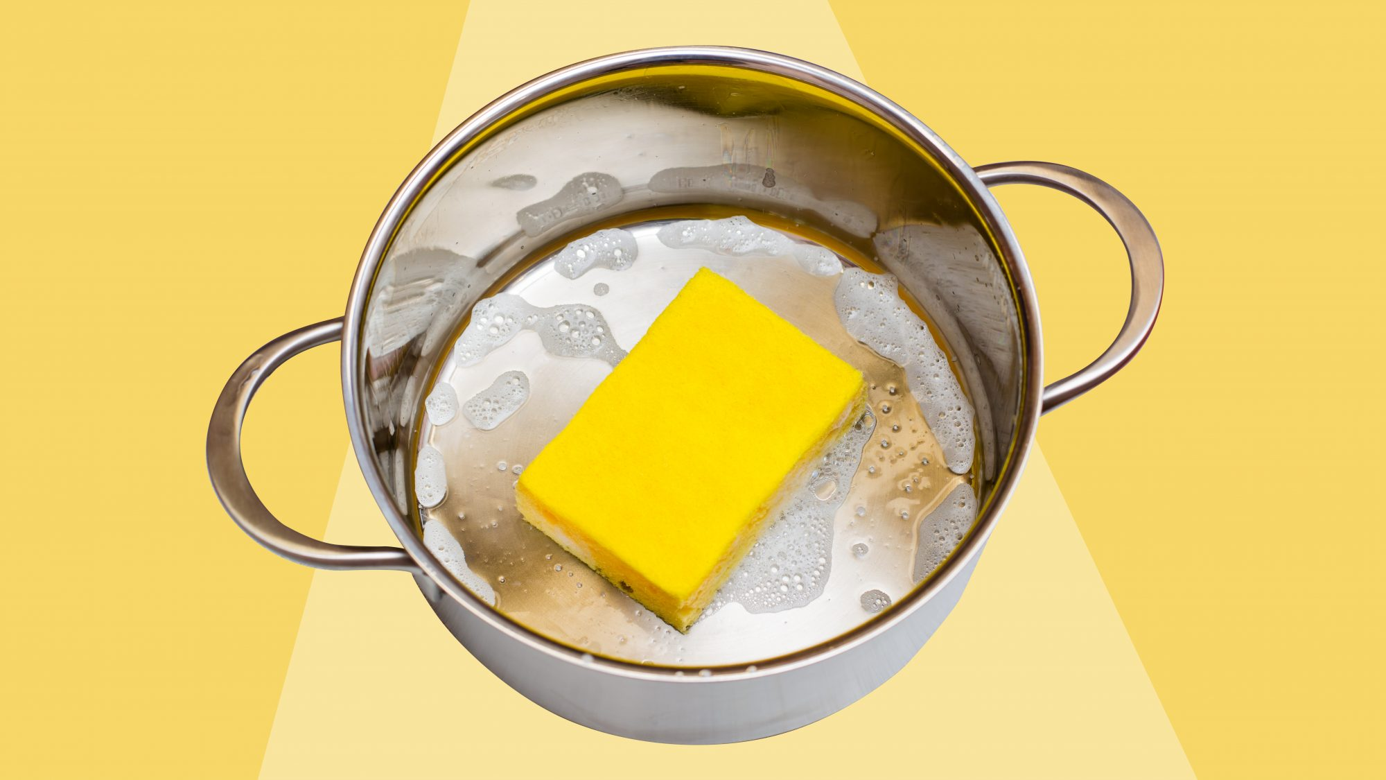 stainless steel cookware with yellow sponge
