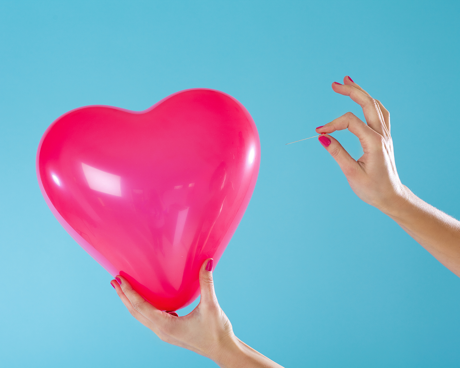 Heart and Nails Popping a Balloon