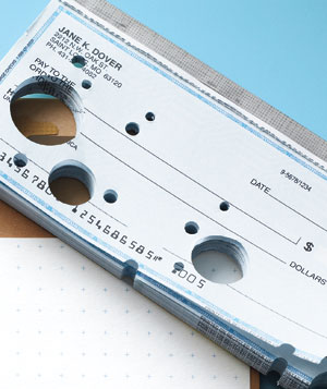 Checkbook with punched-out holes