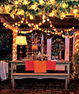 Backyard lit with colorful electric lighting