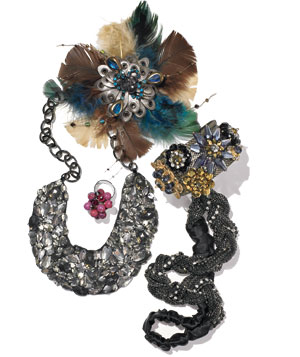 Bejeweled necklace, cuff, feathery brooch, and beaded ring