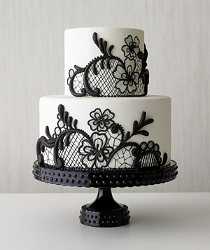 White tiered cake with black lace embellishment