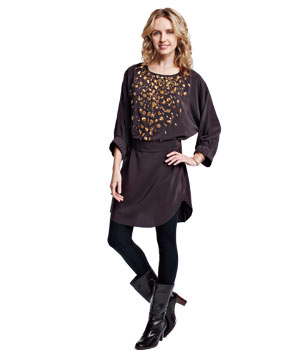 Model in a black tunic with gold embellishments