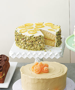 Yellow Cake With Lemon Curd Filling, Lemon Frosting, Chopped Pistachios, and Candied Lemons