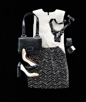 White blouse, simple black patterned skirt, black jewelry and neutral tri-color heels