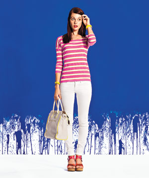 Model wearing pink and white striped shirt and white pants