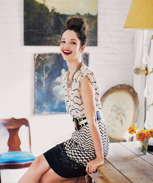 Model wearing zigzag and checker patterned dress