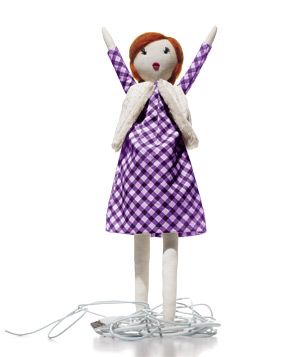 Doll standing on phone charger cord