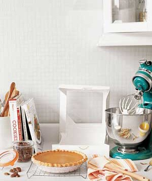 pie with mixer and books on kitchen counter