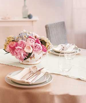 Flowers and plates on a dining table