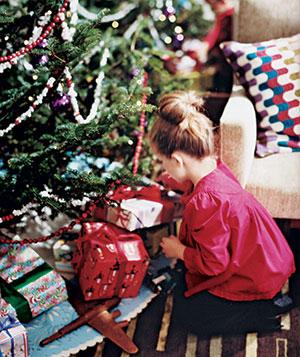 Little girl next to a Christmas tree