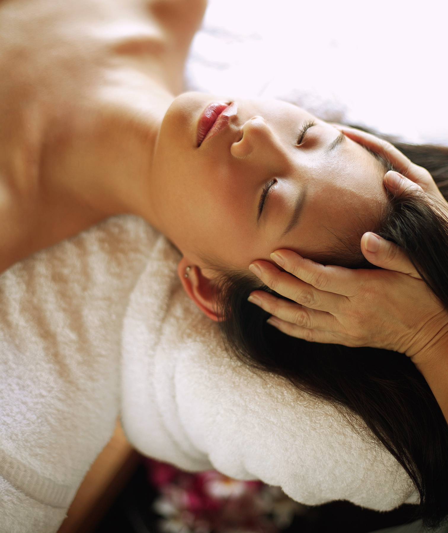Woman receiving massage on table