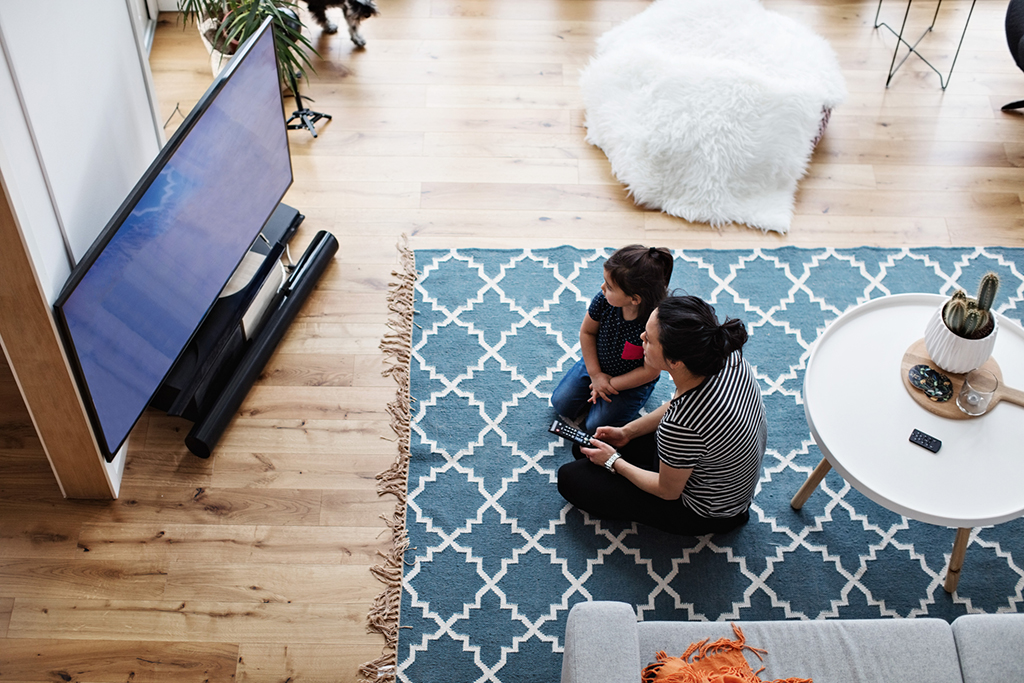 A family watching a Smart TV.