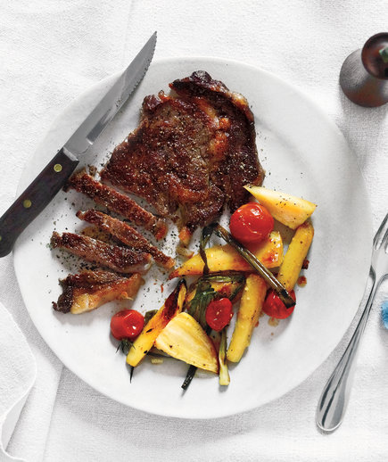 Steak With Roasted Parsnips, Tomatoes, and Scallions