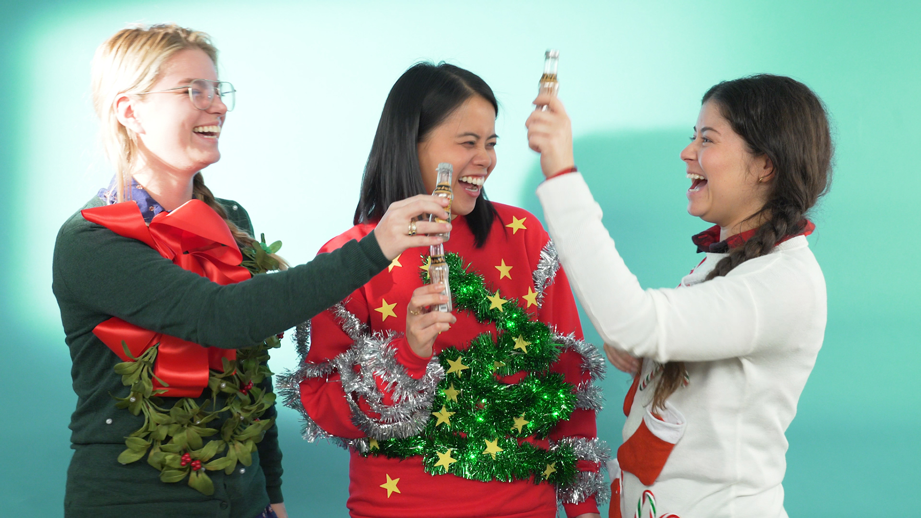 3 women in DIY ugly Christmas sweaters