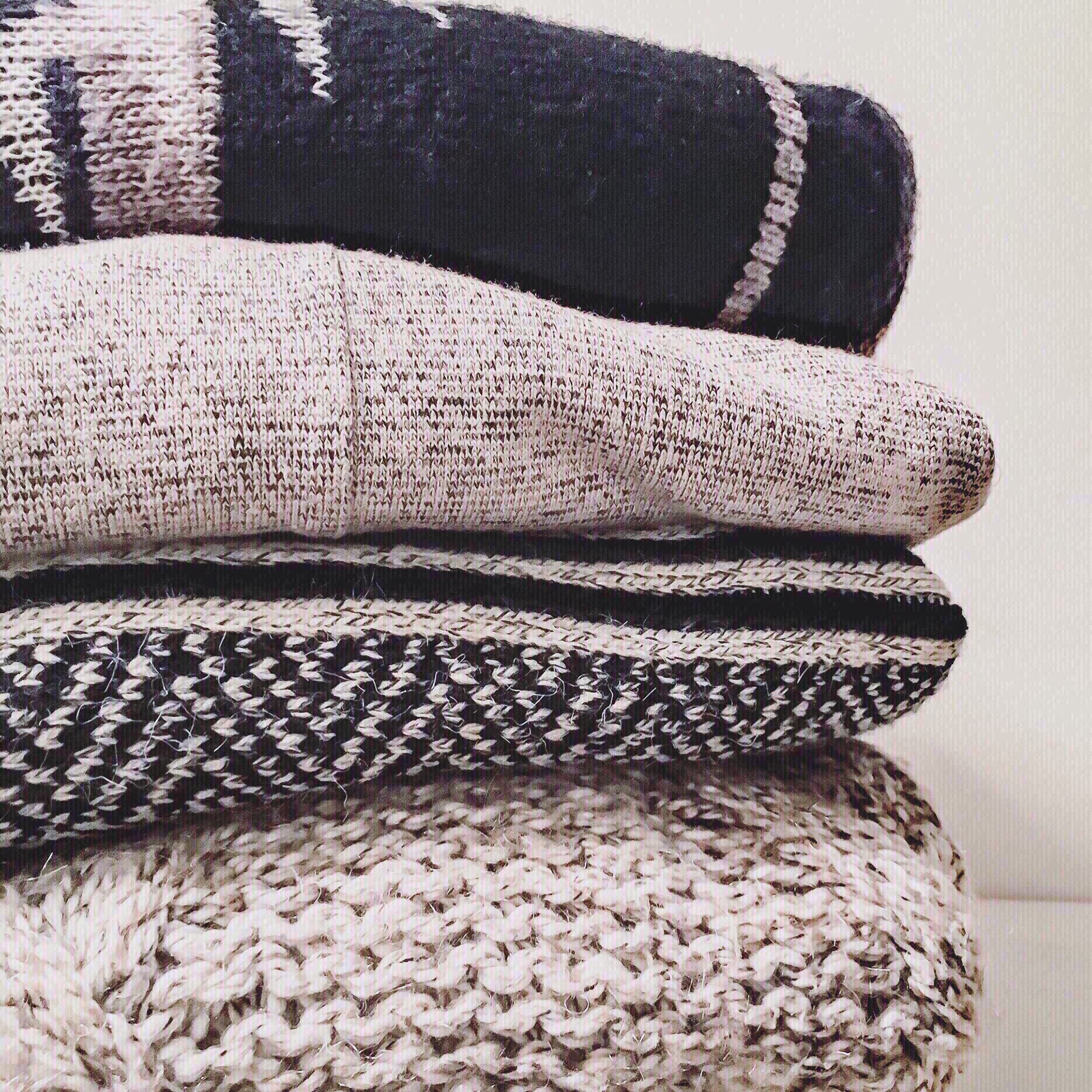Stack of winter sweaters