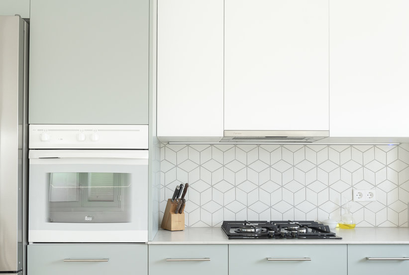 How to Clean Kitchen Cabinets So the Entire Room Will Shine