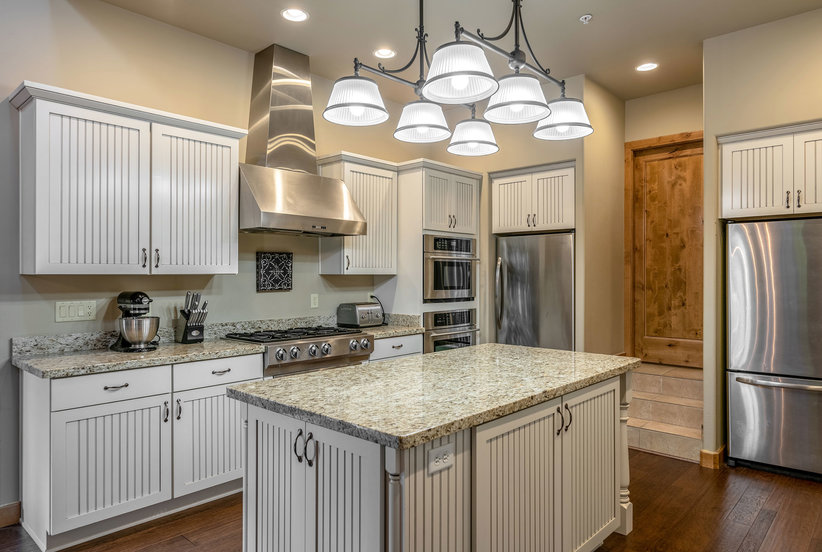 What to Know About Refinishing Kitchen Cabinets   Real ...