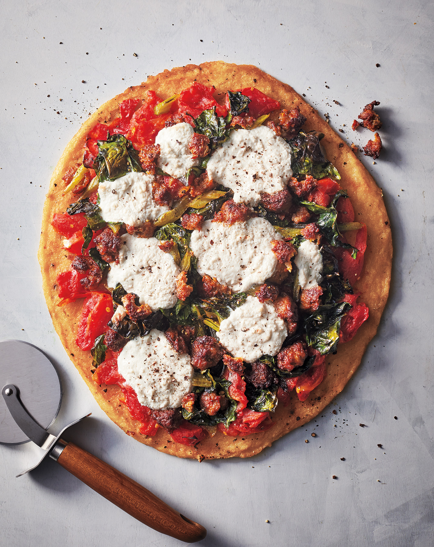 Polenta Pizza With Sausage, Swiss Chard, and Ricotta