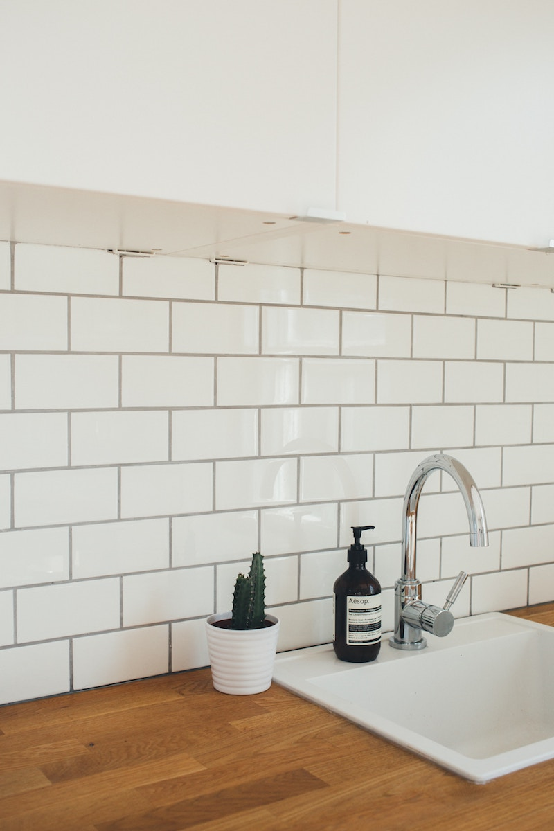How to Clean Bathroom Grout, white tiled bathroom