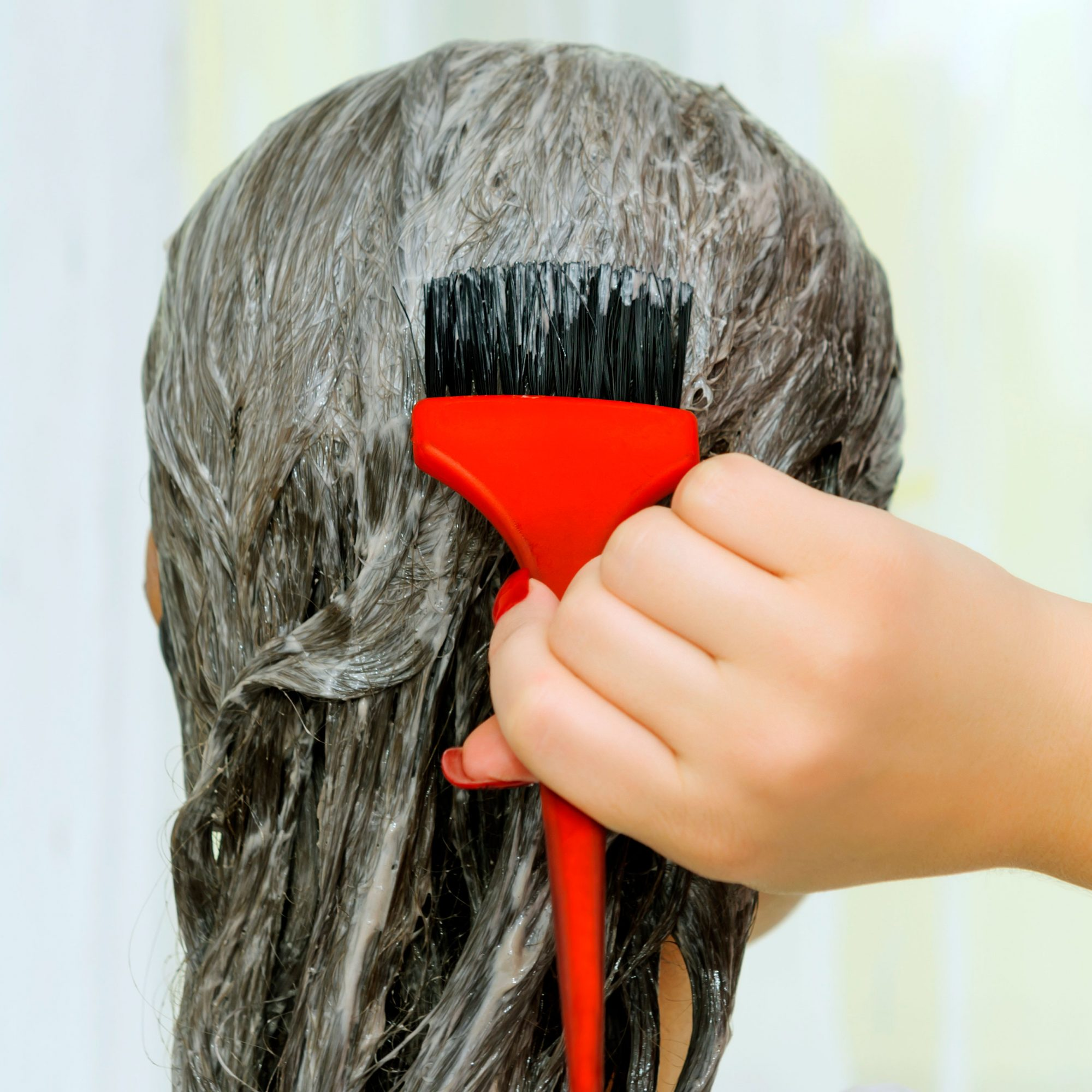 woman applying at-home hair color