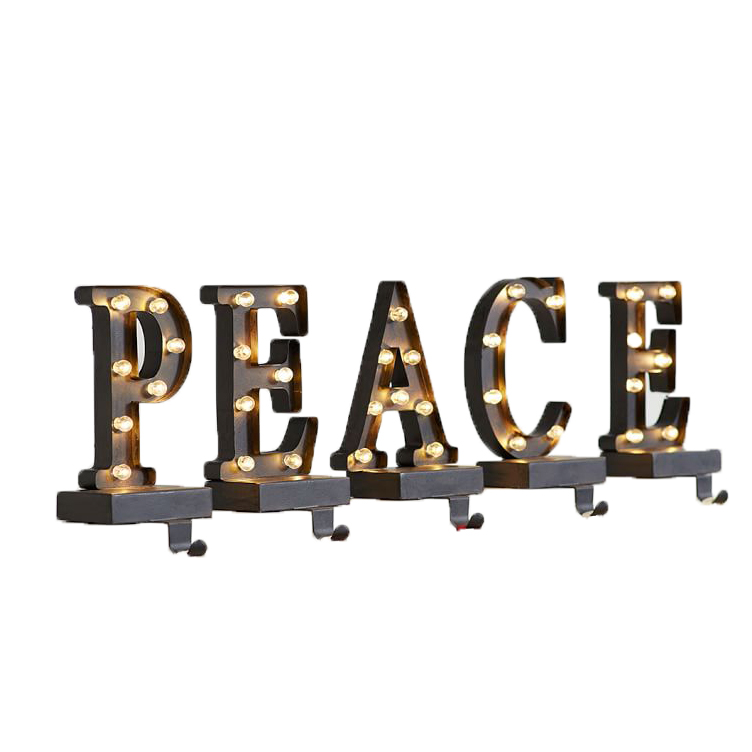 Christmas stocking holders - Pottery Barn Lit Bronze Stocking Holder – Peace