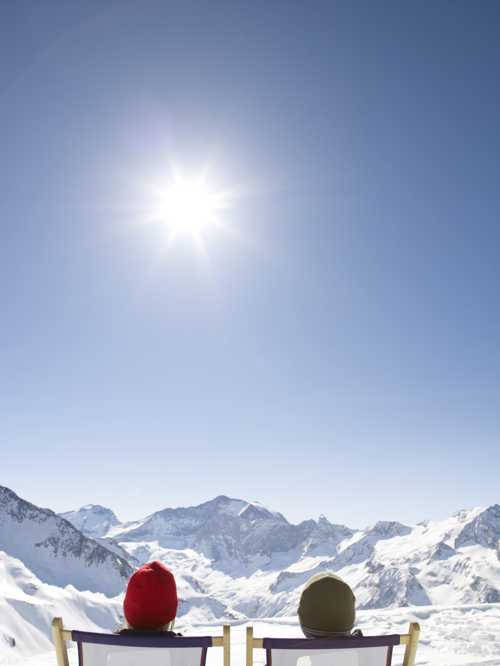 soaking up sun in moutains in winter