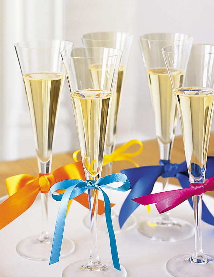 Champagne flutes with ribbon tied to them