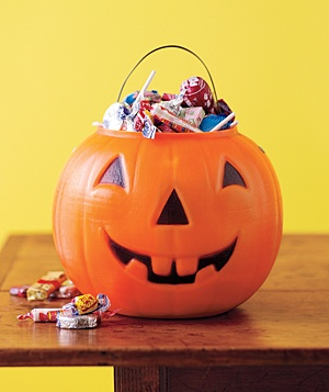 Jack o' lantern filled with Halloween candy