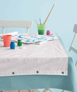 Shower-curtain liner protecting a tablecloth