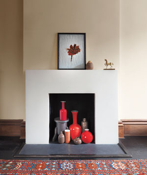 Fireplace filled with red vases