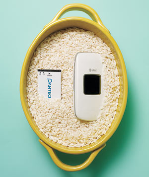 Rice in a pot with a wet cell phone and battery