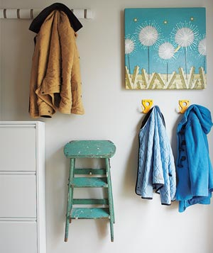 Items hanging at various heights in entry room of home
