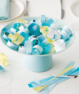 Centerpiece of curled paper notes on a cake stand