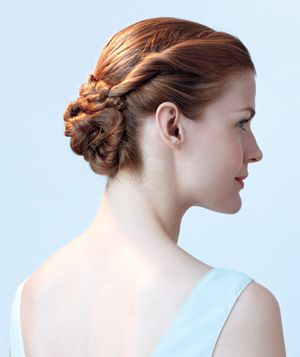 Model wearing a flower bun hairstyle