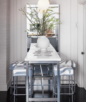 Small table with stools and large mirror