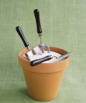 Flower  pot used to hold garden tools