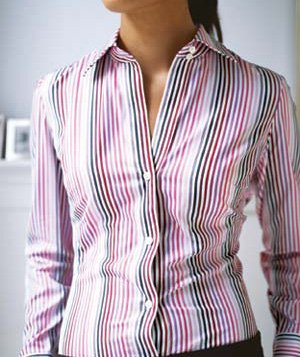 Woman wearing a gaping striped blouse